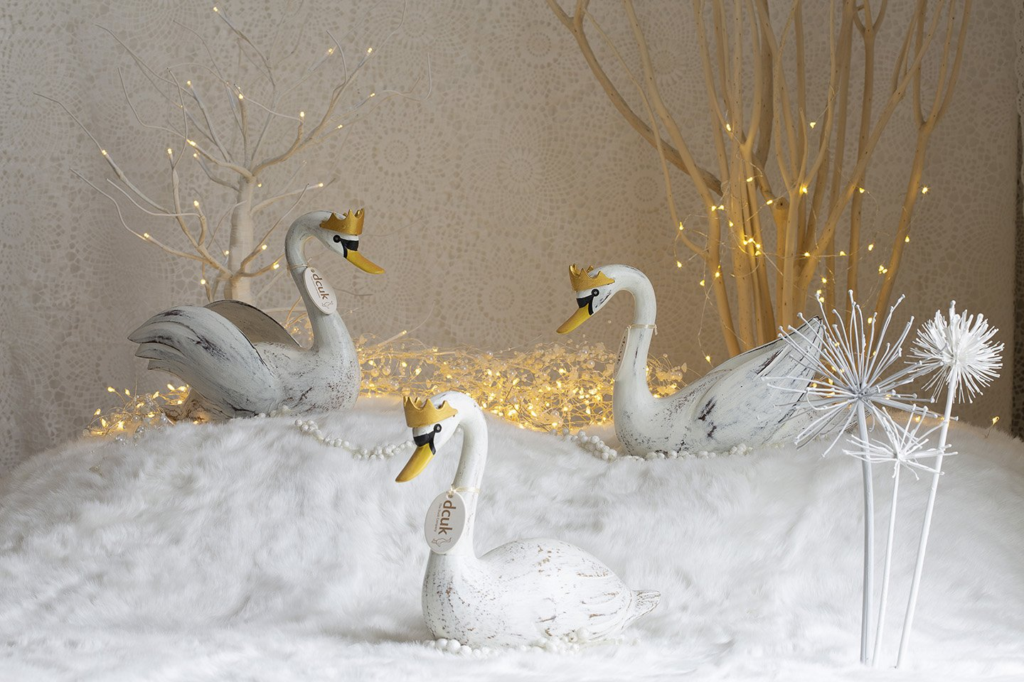 Three DCUK Swans with crowns on