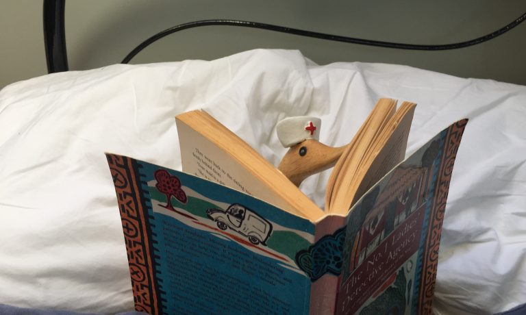 nurse-duckling-reading